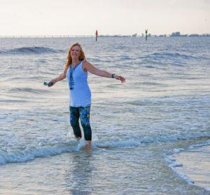 sheree portrait walking on the beach - image
